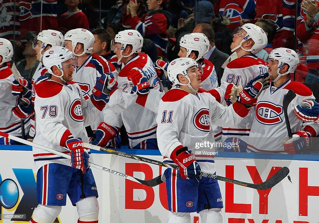 <a gi-track='captionPersonalityLinkClicked' href=/galleries/search?phrase=Brendan+Gallagher&family=editorial&specificpeople=3704208 ng-click='$event.stopPropagation()'>Brendan Gallagher</a> #11 of the Montreal Canadiens celebrates his third period goal with <a gi-track='captionPersonalityLinkClicked' href=/galleries/search?phrase=Andrei+Markov&family=editorial&specificpeople=204528 ng-click='$event.stopPropagation()'>Andrei Markov</a> #79 in their 3-1 win over the Buffalo Sabres on November 27, 2013 at the First Niagara Center in Buffalo, New York.