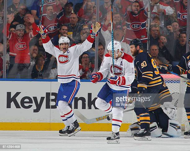Brendan Gallagher of the Montreal Canadiens celebrates his third period goal with teammate Max Pacioretty against the Buffalo Sabres at the KeyBank...
