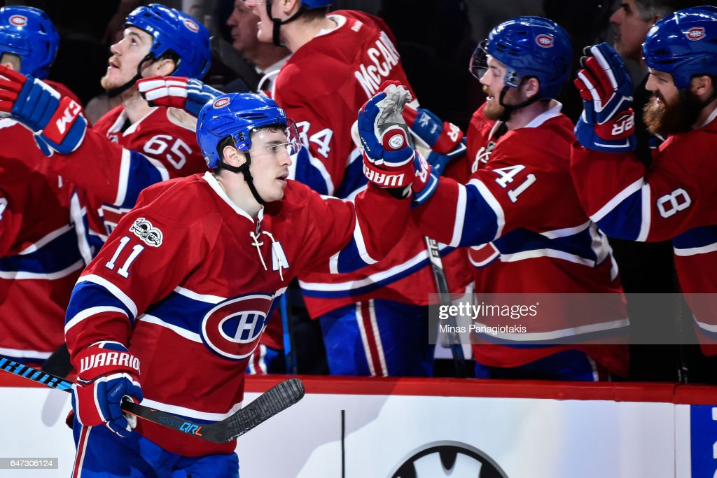 Brendan Gallagher #11 of the Montreal Canadiens celebrates his third period goal with teammates on the bench during the NHL game against the Nashville Predators at the Bell Centre on March 2, 2017 in Montreal, Quebec, Canada. The Montreal Canadiens defeated the Nashville Predators 2-1.