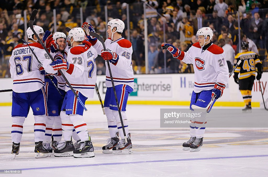 <a gi-track='captionPersonalityLinkClicked' href=/galleries/search?phrase=Brendan+Gallagher&family=editorial&specificpeople=3704208 ng-click='$event.stopPropagation()'>Brendan Gallagher</a> #11 of the Montreal Canadiens celebrates with teammates after scoring the game-winning goal in an overtime shootout against the Boston Bruins during the game on March 27, 2013 at TD Garden in Boston, Massachusetts.