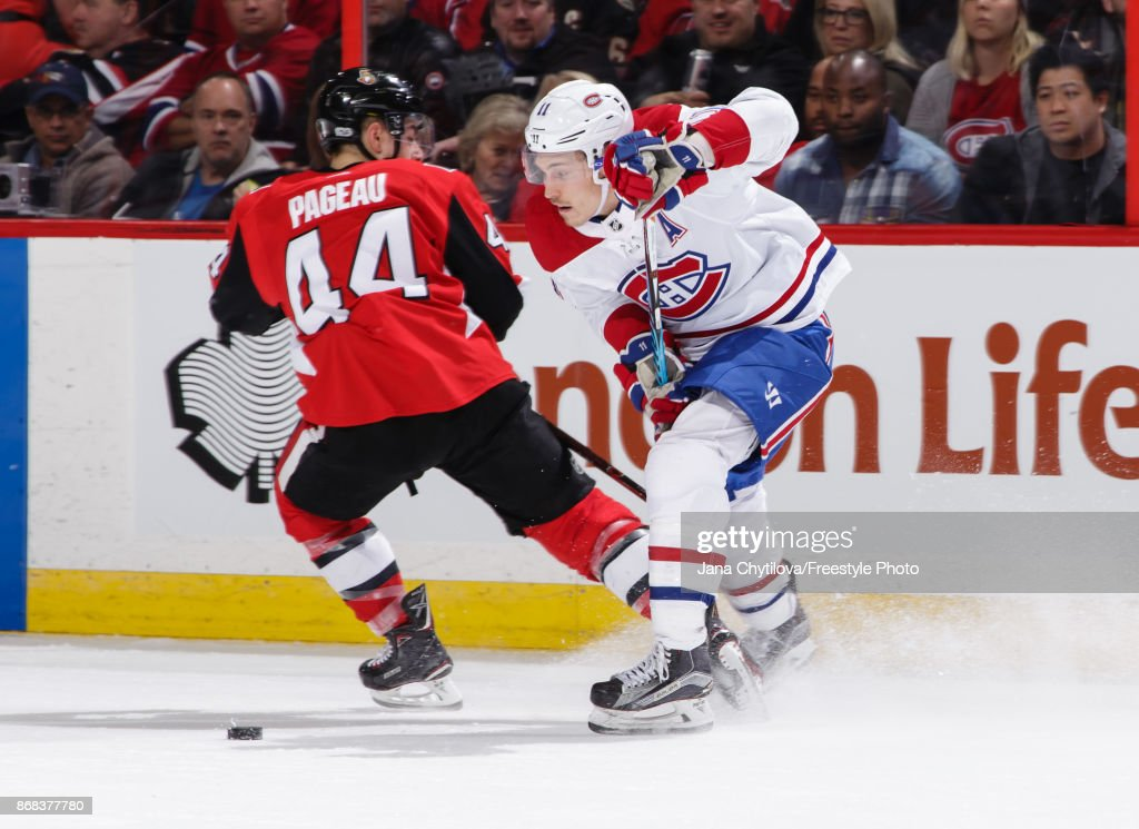 Brendan Gallagher #11 of the Montreal Canadiens chips the puck past Jean-Gabriel Pageau #44 of the Ottawa Senators in the second period at Canadian Tire Centre on October 30, 2017 in Ottawa, Ontario, Canada.
