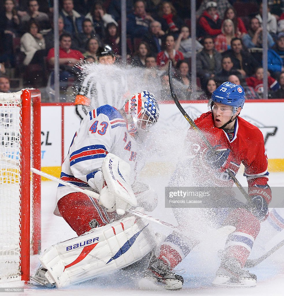 Brendan Gallagher #73 of the Montreal Canadiens collides with goaltender <a gi-track='captionPersonalityLinkClicked' href=/galleries/search?phrase=Martin+Biron&family=editorial&specificpeople=203146 ng-click='$event.stopPropagation()'>Martin Biron</a> #43 of the New York Rangers during the NHL game on February 23, 2013 at the Bell Centre in Montreal, Quebec, Canada.