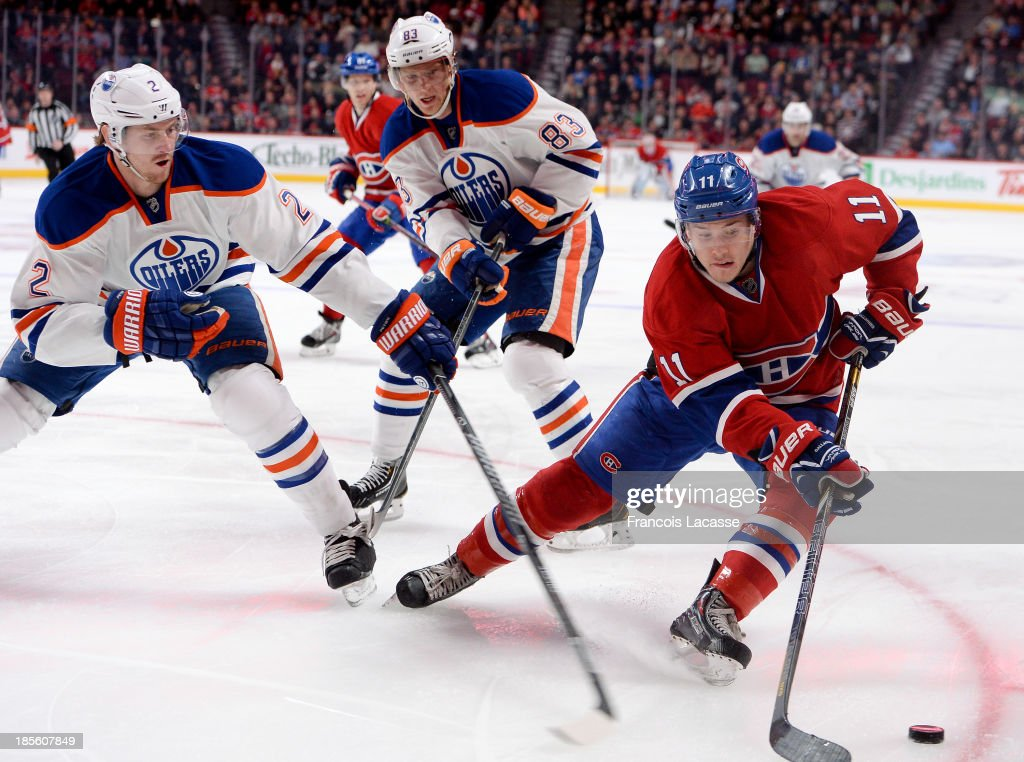<a gi-track='captionPersonalityLinkClicked' href=/galleries/search?phrase=Brendan+Gallagher&family=editorial&specificpeople=3704208 ng-click='$event.stopPropagation()'>Brendan Gallagher</a> #11 of the Montreal Canadiens controls the puck while being challenged by <a gi-track='captionPersonalityLinkClicked' href=/galleries/search?phrase=Jeff+Petry&family=editorial&specificpeople=570439 ng-click='$event.stopPropagation()'>Jeff Petry</a> #2 and <a gi-track='captionPersonalityLinkClicked' href=/galleries/search?phrase=Ales+Hemsky&family=editorial&specificpeople=202828 ng-click='$event.stopPropagation()'>Ales Hemsky</a> #83 of the Edmonton Oilers during the NHL game on October 22, 2013 at the Bell Centre in Montreal, Quebec, Canada.