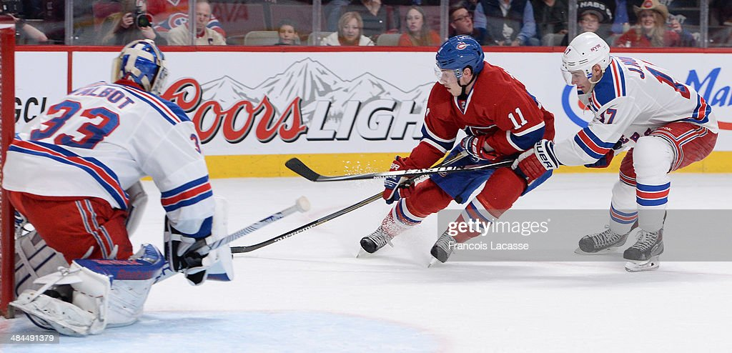 <a gi-track='captionPersonalityLinkClicked' href=/galleries/search?phrase=Brendan+Gallagher&family=editorial&specificpeople=3704208 ng-click='$event.stopPropagation()'>Brendan Gallagher</a> #11 of the Montreal Canadiens controls the puck while being challenged by John Moore #17 of the New York Rangers during the NHL game on April 12, 2014 at the Bell Centre in Montreal, Quebec, Canada.