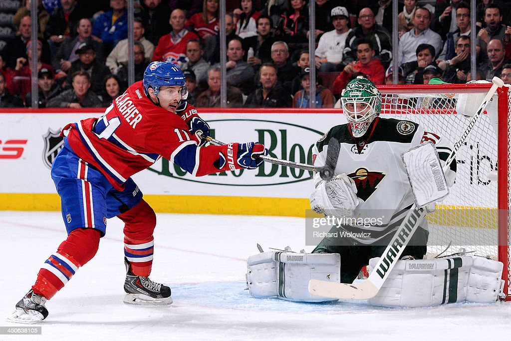 Brendan Gallagher #11 of the Montreal Canadiens deflects the puck in front of goalie Josh Harding #37 of the Minnesota Wild during the NHL game at the Bell Centre on November 19, 2013 in Montreal, Quebec, Canada