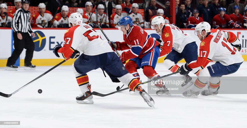 <a gi-track='captionPersonalityLinkClicked' href=/galleries/search?phrase=Brendan+Gallagher&family=editorial&specificpeople=3704208 ng-click='$event.stopPropagation()'>Brendan Gallagher</a> #11 of the Montreal Canadiens, fights for the puck against <a gi-track='captionPersonalityLinkClicked' href=/galleries/search?phrase=Marcel+Goc&family=editorial&specificpeople=541626 ng-click='$event.stopPropagation()'>Marcel Goc</a> #57, Dmitry Kulikov #7 and Jesse Winchester #17 of the Florida Panthers during the NHL game on December 15, 2013 at the Bell Centre in Montreal, Quebec, Canada.
