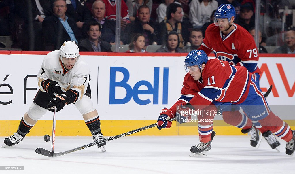 <a gi-track='captionPersonalityLinkClicked' href=/galleries/search?phrase=Brendan+Gallagher&family=editorial&specificpeople=3704208 ng-click='$event.stopPropagation()'>Brendan Gallagher</a> #11 of the Montreal Canadiens fights for the puck against <a gi-track='captionPersonalityLinkClicked' href=/galleries/search?phrase=Andrew+Cogliano&family=editorial&specificpeople=869296 ng-click='$event.stopPropagation()'>Andrew Cogliano</a> #7 of the Anaheim Ducks while <a gi-track='captionPersonalityLinkClicked' href=/galleries/search?phrase=Andrei+Markov&family=editorial&specificpeople=204528 ng-click='$event.stopPropagation()'>Andrei Markov</a> #79 follows the action, during the NHL game on October 24, 2013 at the Bell Centre in Montreal, Quebec, Canada.