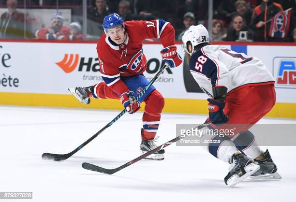 Brendan Gallagher of the Montreal Canadiens fires a shot against David Savard of the Columbus Blue Jackets in the NHL game at the Bell Centre on...