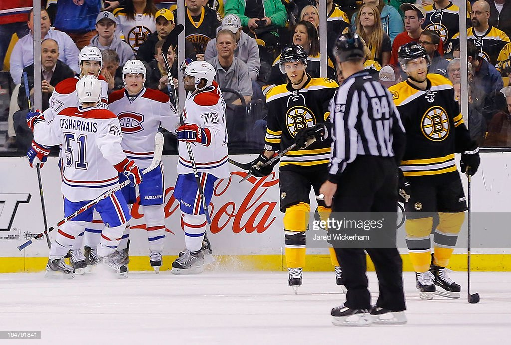 <a gi-track='captionPersonalityLinkClicked' href=/galleries/search?phrase=Brendan+Gallagher&family=editorial&specificpeople=3704208 ng-click='$event.stopPropagation()'>Brendan Gallagher</a> #11 of the Montreal Canadiens is congratulated by teammates after scoring a goal in the third period against the Boston Bruins during the game on March 27, 2013 at TD Garden in Boston, Massachusetts.