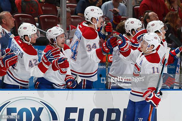 Brendan Gallagher of the Montreal Canadiens is congratulated by teammates after scoring a first period goal against the Florida Panthers at the BBT...