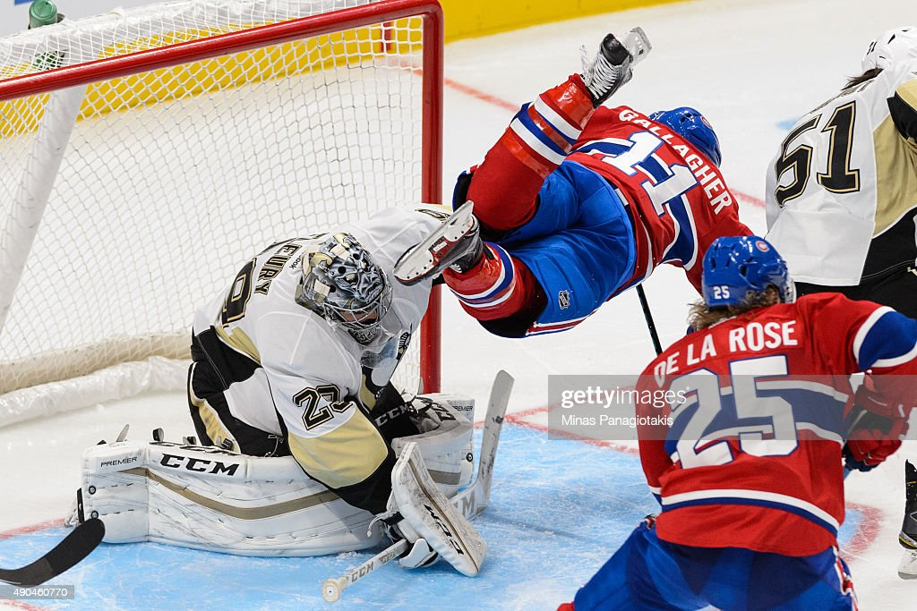 Brendan Gallagher #11 of the Montreal Canadiens jumps over goaltender Marc-Andre Fleury #29 of the Pittsburgh Penguins during a NHL pre-season game at the Videotron Centre on September 28, 2015 in Quebec City, Quebec, Canada. The Montreal Canadiens defeated the Pittsburgh Penguins 4-1.