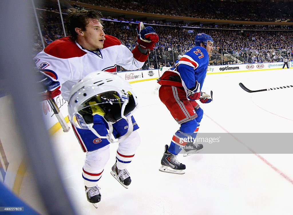 <a gi-track='captionPersonalityLinkClicked' href=/galleries/search?phrase=Brendan+Gallagher&family=editorial&specificpeople=3704208 ng-click='$event.stopPropagation()'>Brendan Gallagher</a> #11 of the Montreal Canadiens looses his helmet against <a gi-track='captionPersonalityLinkClicked' href=/galleries/search?phrase=Ryan+McDonagh&family=editorial&specificpeople=4324983 ng-click='$event.stopPropagation()'>Ryan McDonagh</a> #27 of the New York Rangers in Game Three of the Eastern Conference Final during the 2014 NHL Stanley Cup Playoffs at Madison Square Garden on May 22, 2014 in New York City.