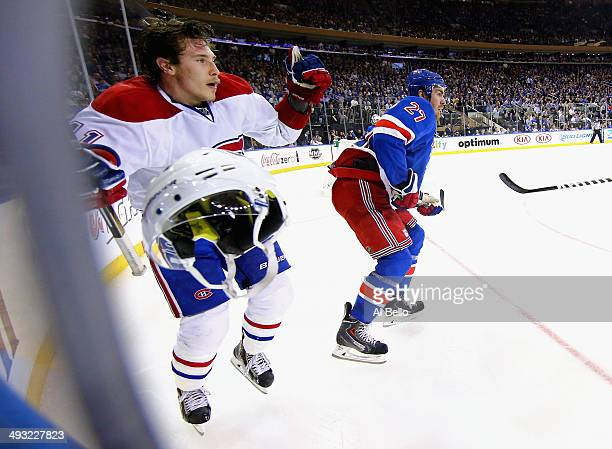 Brendan Gallagher of the Montreal Canadiens looses his helmet against Ryan McDonagh of the New York Rangers in Game Three of the Eastern Conference...
