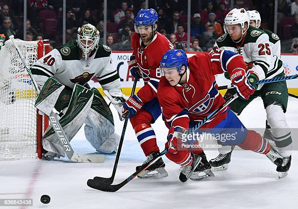 Brendan Gallagher of the Montreal Canadiens loses control of the puck against Jonas Brodin of the Minnesota Wild in the NHL game at the Bell Centre...