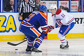 Brendan Gallagher of the Montreal Canadiens moves the puck against Andrew Ference of the Edmonton Oilers during an NHL game at Rexall Place on...