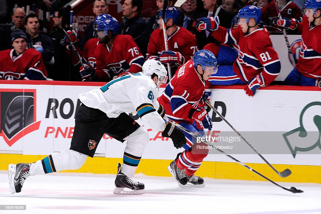 <a gi-track='captionPersonalityLinkClicked' href=/galleries/search?phrase=Brendan+Gallagher&family=editorial&specificpeople=3704208 ng-click='$event.stopPropagation()'>Brendan Gallagher</a> #11 of the Montreal Canadiens moves the puck past Justin Braun #61 of the San Jose Sharks during the NHL game at the Bell Centre on October 26, 2013 in Montreal, Quebec, Canada. The Sharks defeated the Canadiens 2-0.