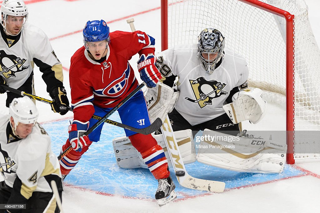 Brendan Gallagher #11 of the Montreal Canadiens screens goaltender Marc-Andre Fleury #29 of the Pittsburgh Penguins during the NHL pre-season game at the Videotron Centre on September 28, 2015 in Quebec City, Quebec, Canada.