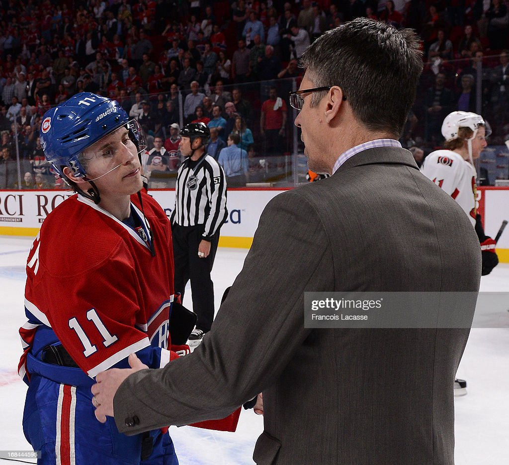<a gi-track='captionPersonalityLinkClicked' href=/galleries/search?phrase=Brendan+Gallagher&family=editorial&specificpeople=3704208 ng-click='$event.stopPropagation()'>Brendan Gallagher</a> #11 of the Montreal Canadiens shake hands with David Cameron, Assistant Coach of the Ottawa Senators after Game Five of the Eastern Conference Quarterfinals during the 2013 NHL Stanley Cup Playoffs at the Bell Centre on May 9, 2013 in Montreal, Quebec, Canada.