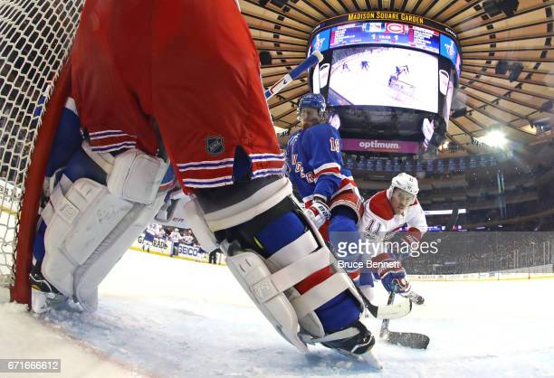 Brendan Gallagher of the Montreal Canadiens shoots the puck against Marc Staal and Henrik Lundqvist of the New York Rangers n Game Six of the Eastern...