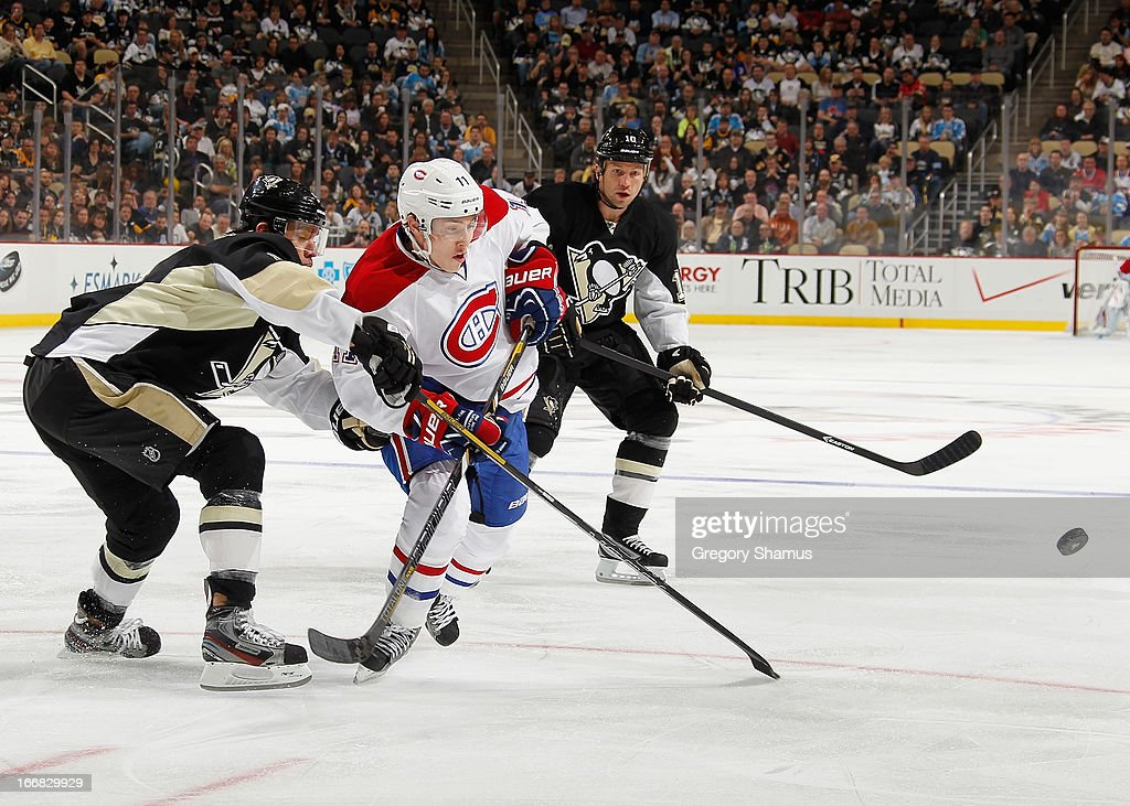 <a gi-track='captionPersonalityLinkClicked' href=/galleries/search?phrase=Brendan+Gallagher&family=editorial&specificpeople=3704208 ng-click='$event.stopPropagation()'>Brendan Gallagher</a> #11 of the Montreal Canadiens skates for the loose puck between the defense of <a gi-track='captionPersonalityLinkClicked' href=/galleries/search?phrase=Pascal+Dupuis&family=editorial&specificpeople=208971 ng-click='$event.stopPropagation()'>Pascal Dupuis</a> #9 and <a gi-track='captionPersonalityLinkClicked' href=/galleries/search?phrase=Brenden+Morrow&family=editorial&specificpeople=202256 ng-click='$event.stopPropagation()'>Brenden Morrow</a> #10 of the Pittsburgh Penguins on April17, 2013 at Consol Energy Center in Pittsburgh, Pennsylvania.