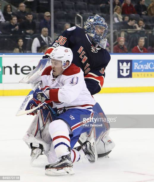 Brendan Gallagher of the Montreal Canadiens skates into goalie Henrik Lundqvist of the New York Rangers in an NHL hockey game at Madison Square...