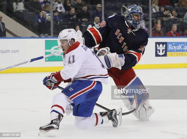 Brendan Gallagher of the Montreal Canadiens skates into the arm of goalie Henrik Lundqvist of the New York Rangers on this rush towards the goal in...
