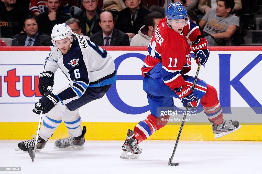 <a gi-track='captionPersonalityLinkClicked' href=/galleries/search?phrase=Brendan+Gallagher&family=editorial&specificpeople=3704208 ng-click='$event.stopPropagation()'>Brendan Gallagher</a> #11 of the Montreal Canadiens skates with the puck in front of <a gi-track='captionPersonalityLinkClicked' href=/galleries/search?phrase=Ron+Hainsey&family=editorial&specificpeople=206345 ng-click='$event.stopPropagation()'>Ron Hainsey</a> #6 of the Winnipeg Jets during the NHL game at the Bell Centre on April 4, 2013 in Montreal, Quebec, Canada. The Canadiens defeated the Jets 4-1.