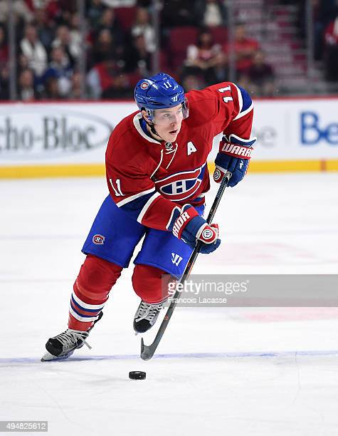 Brendan Gallagher of the Montreal Canadiens skates with the puck against the Toronto Maple Leafs in the NHL game at the Bell Centre on October 24...