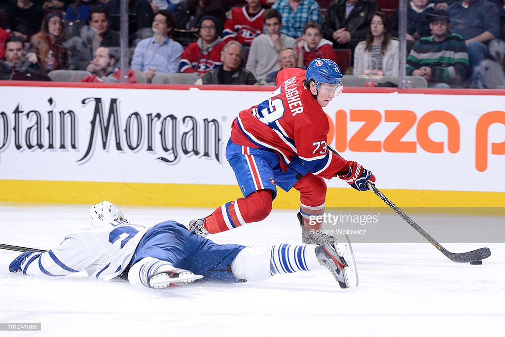 Brendan Gallagher #73 of the Montreal Canadiens stick handles the puck past <a gi-track='captionPersonalityLinkClicked' href=/galleries/search?phrase=John-Michael+Liles&family=editorial&specificpeople=206866 ng-click='$event.stopPropagation()'>John-Michael Liles</a> #24 of the Toronto Maple Leafs during the NHL game at the Bell Centre on February 9, 2013 in Montreal, Quebec, Canada. The Maple Leafs defeated the Canadiens 6-0.