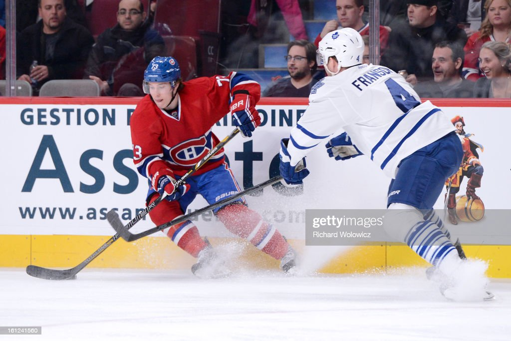 Brendan Gallagher #73 of the Montreal Canadiens stops with the puck in front of <a gi-track='captionPersonalityLinkClicked' href=/galleries/search?phrase=Cody+Franson&family=editorial&specificpeople=2125769 ng-click='$event.stopPropagation()'>Cody Franson</a> #4 of the Toronto Maple Leafs during the NHL game at the Bell Centre on February 9, 2013 in Montreal, Quebec, Canada. The Maple Leafs defeated the Canadiens 6-0.