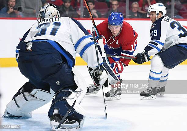 Brendan Gallagher of the Montreal Canadiens takes a shot on goal Ondrej Pavelec of the Winnipeg Jets in the NHL game at the Bell Centre on November 1...