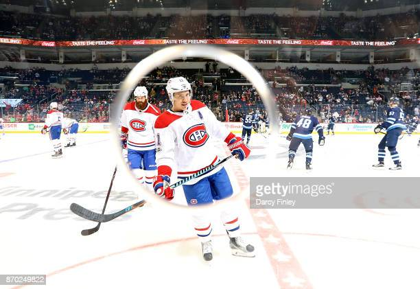 Brendan Gallagher of the Montreal Canadiens takes part in the pregame warm up prior to NHL action against the Winnipeg Jets at the Bell MTS Place on...