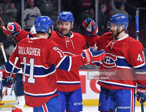 Brendan Gallagher Tomas Plekanec and Paul Byron of the Montreal Canadiens celebrate a goal against the Florida Panthers in the NHL game at the Bell...