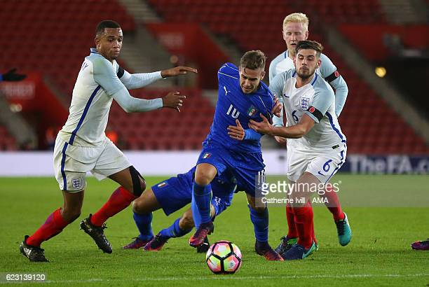 Brendan Galloway of England U21 and Jack Stephens of England U21 try to stop Federico Ricci of Italy U21 during the U21 International Friendly match...