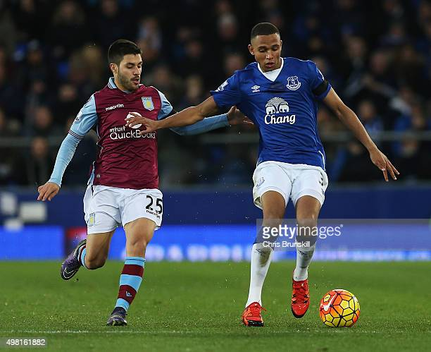 Brendan Galloway of Everton and Carles Gil of Aston Villa compete for the ball during the Barclays Premier League match between Everton and Aston...