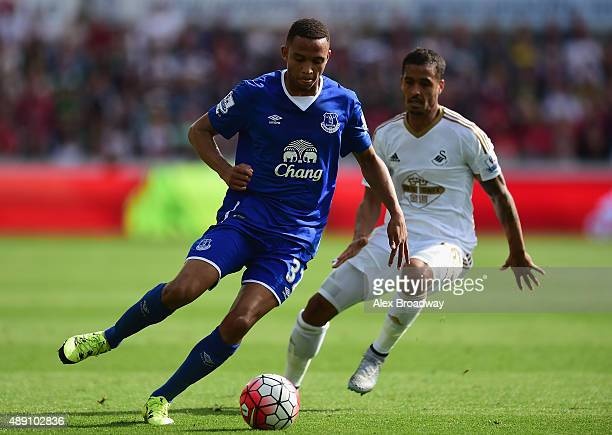 Brendan Galloway of Everton and Kyle Naughton of Swansea City compete for the ball during the Barclays Premier League match between Swansea City and...
