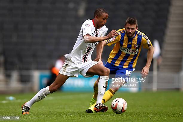 Brendan Galloway of MK Dons takes the ball past Stuart Dallas of Brentford during the Sky Bet League One match between MK Dons and Brentford at...