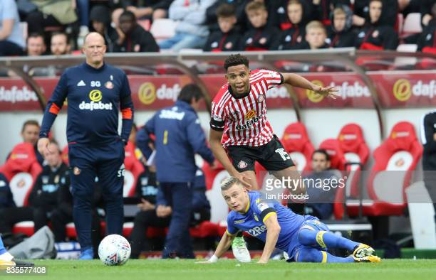 Brendan Galloway of Sunderland brings down Ezgjan Alioski of Leeds during the Sky Bet Championship match between Sunderland and Leeds United at...