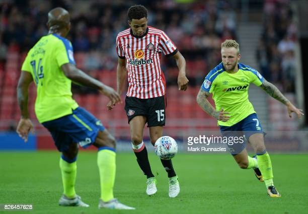 Brendan Galloway of Sunderland takes on Andre Wisdom and Johnny Russell of Derby County during the Sky Bet Championship match between Sunderland and...