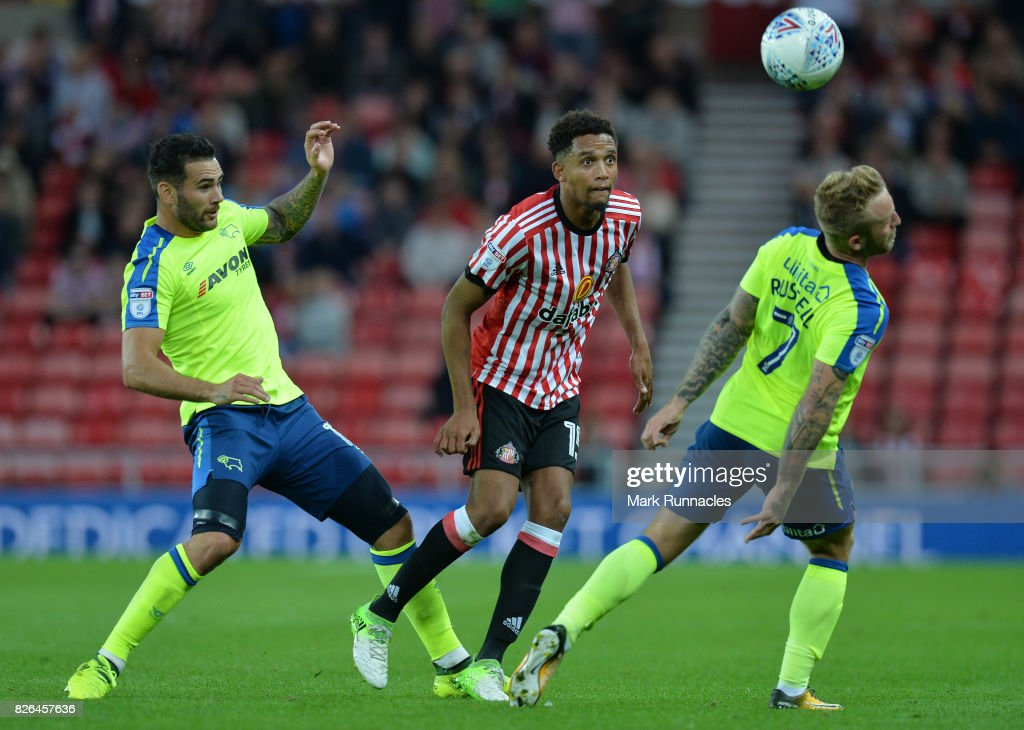 Brendan Galloway of Sunderland takes on Bradley Johnson and Johnny Russell of Derby County during the Sky Bet Championship match between Sunderland and Derby County at Stadium of Light on August 4, 2017 in Sunderland, England.