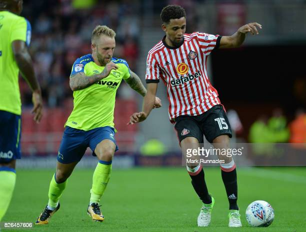 Brendan Galloway of Sunderland takes on Johnny Russell of Derby County during the Sky Bet Championship match between Sunderland and Derby County at...