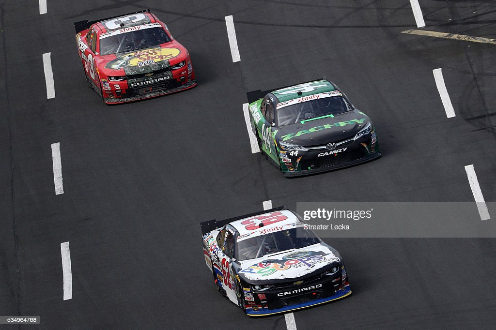 <a gi-track='captionPersonalityLinkClicked' href=/galleries/search?phrase=Brendan+Gaughan&family=editorial&specificpeople=243004 ng-click='$event.stopPropagation()'>Brendan Gaughan</a>, driver of the #62 Pit Stops For Hope Chevrolet, leads JJ Yeley, driver of the #44 Zachry Toyota, and <a gi-track='captionPersonalityLinkClicked' href=/galleries/search?phrase=Ty+Dillon&family=editorial&specificpeople=6312493 ng-click='$event.stopPropagation()'>Ty Dillon</a>, driver of the #3 Bass Pro Shops/Tracker Chevrolet, during the NASCAR XFINITY Series Hisense 300 at Charlotte Motor Speedway on May 28, 2016 in Charlotte, North Carolina.