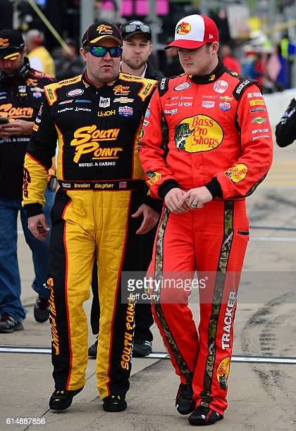 Brendan Gaughan driver of the South Point Chevrolet and Ty Dillon driver of the Bass Pro Shops Chevrolet talk on the grid prior to the NASCAR XFINITY...