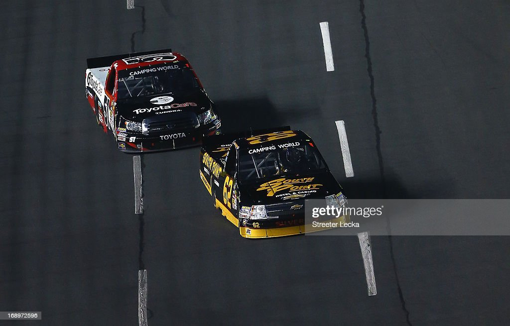 <a gi-track='captionPersonalityLinkClicked' href=/galleries/search?phrase=Brendan+Gaughan&family=editorial&specificpeople=243004 ng-click='$event.stopPropagation()'>Brendan Gaughan</a>, driver of the #62 South Point Chevrolet, leads <a gi-track='captionPersonalityLinkClicked' href=/galleries/search?phrase=Kyle+Busch&family=editorial&specificpeople=211123 ng-click='$event.stopPropagation()'>Kyle Busch</a>, driver of the #51 Toyota Care Toyota, during the NASCAR Camping World Truck Series North Carolina Education Lottery 200 at Charlotte Motor Speedway on May 17, 2013 in Concord, North Carolina.