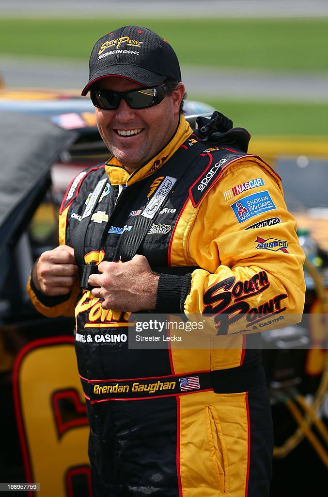 Brendan Gaughan, driver of the #62 South Point Chevrolet, stands on pit road during qualifying for the NASCAR Camping World Truck Series North Carolina Education Lottery 200 at Charlotte Motor Speedway on May 17, 2013 in Concord, North Carolina.