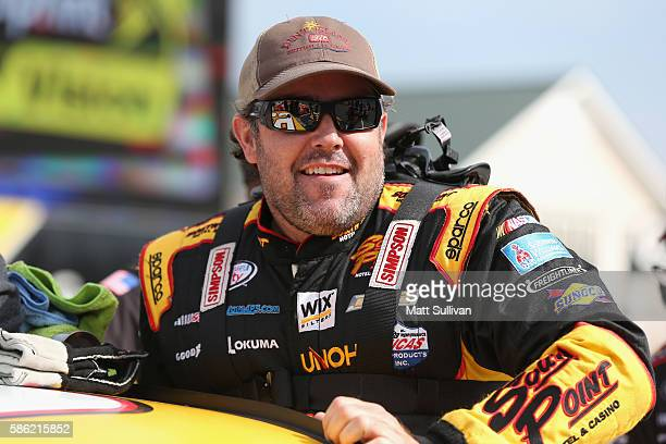Brendan Gaughan driver of the South Point Chevrolet stands on the grid during qualifying for the NASCAR XFINITY Series Zippo 200 at Watkins Glen...