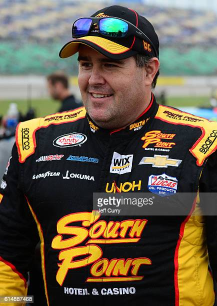 Brendan Gaughan driver of the South Point Chevrolet stands on the grid prior to the NASCAR XFINITY Series Kansas Lottery 300 at Kansas Speedway on...