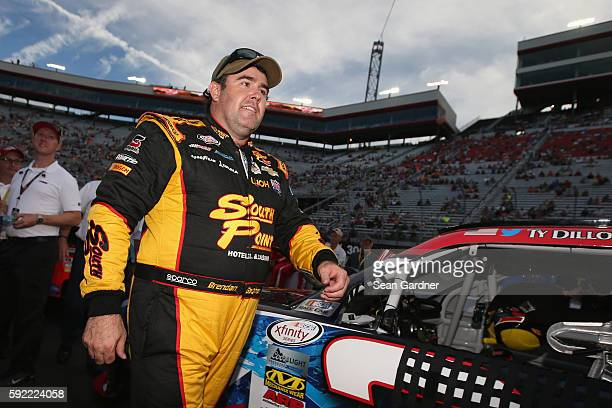 Brendan Gaughan driver of the South Point Chevrolet walks on the grid prior to the NASCAR XFINITY Series Food City 300 at Bristol Motor Speedway on...
