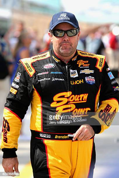 Brendan Gaughan driver of the South Point Chevrolet walks on the grid during qualifying for the NASCAR XFINITY Series Ford EcoBoost 300 at...
