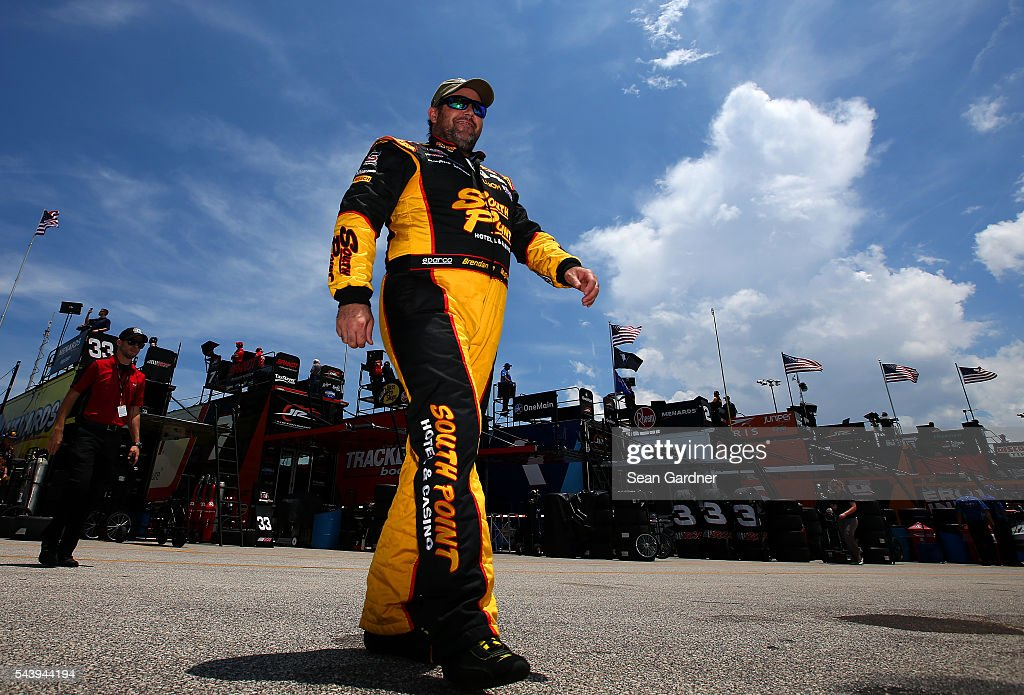 <a gi-track='captionPersonalityLinkClicked' href=/galleries/search?phrase=Brendan+Gaughan&family=editorial&specificpeople=243004 ng-click='$event.stopPropagation()'>Brendan Gaughan</a>, driver of the #62 South Point Chevrolet, walks through the garage area during practice for the NASCAR XFINITY Series Subway Firecracker 250 at Daytona International Speedway on June 30, 2016 in Daytona Beach, Florida.